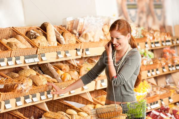 Stok fotoğraf: Bakkal · kadın · cep · telefonu · süpermarket · gıda