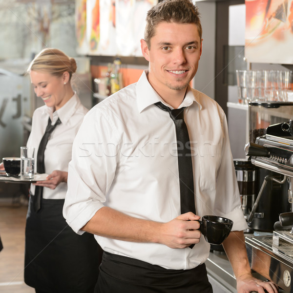 Handsome waiter making coffee espresso machine Stock photo © CandyboxPhoto