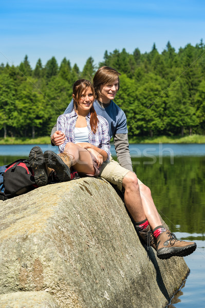 Young couple hikers lounging at lake nature Stock photo © CandyboxPhoto