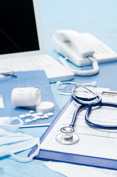 Stock photo: Doctor's office desk with medical accessories
