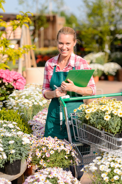 Garden center woman put potted flowers cart Stock photo © CandyboxPhoto