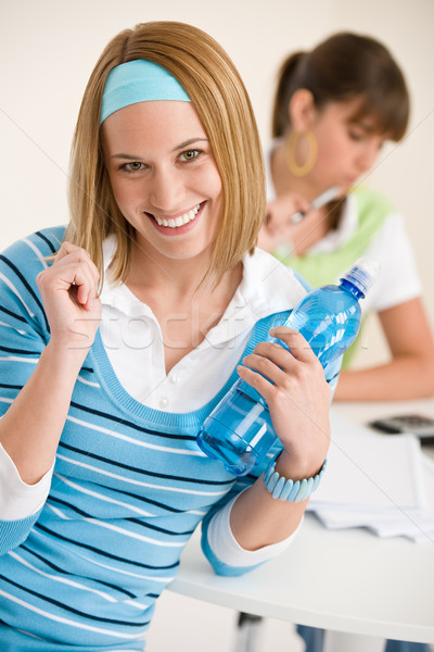 Student at home - smiling woman with bottle of water Stock photo © CandyboxPhoto