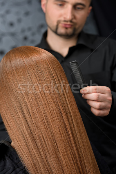 Stock photo: Professional hairdresser with fashion model at luxury salon