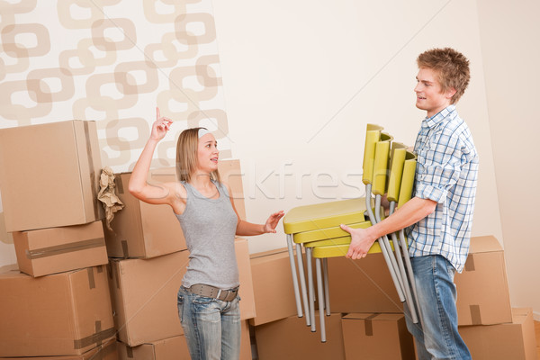 Moving house: Man and woman with box and chair Stock photo © CandyboxPhoto