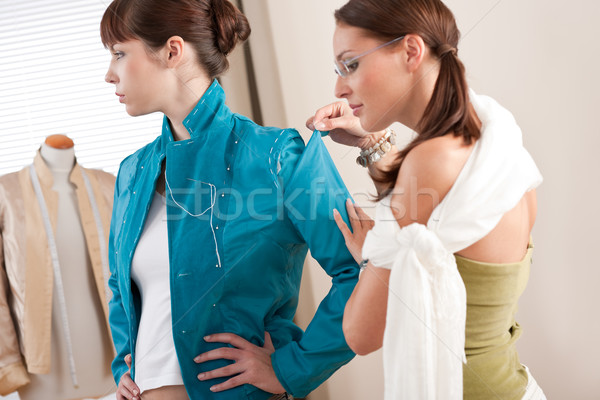 Model fitting by female fashion designer Stock photo © CandyboxPhoto