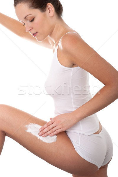 Body care series - Beautiful young woman applying cream on her l Stock photo © CandyboxPhoto