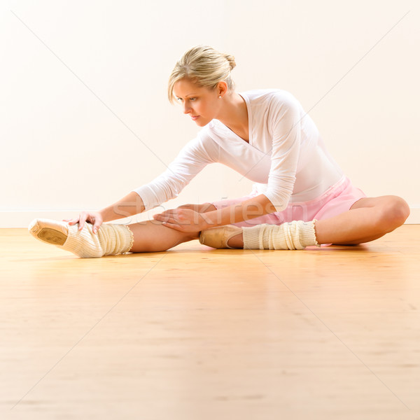 Beautiful ballet dancer stretching in the studio Stock photo © CandyboxPhoto