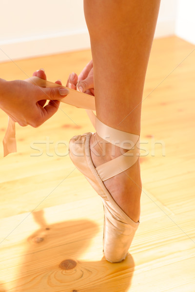 Close-up of ballerina tying her pointe shoe Stock photo © CandyboxPhoto
