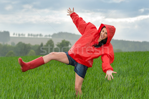 Playful teenage girl dancing in the rain Stock photo © CandyboxPhoto