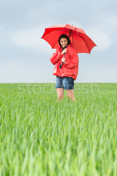Elated teenage girl holding red umbrella Stock photo © CandyboxPhoto