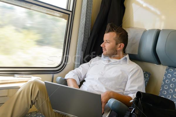 Uomo guardando fuori treno finestra laptop Foto d'archivio © CandyboxPhoto