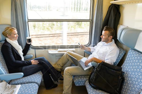 男 女性 座って 列車 話し 笑みを浮かべて ストックフォト © CandyboxPhoto