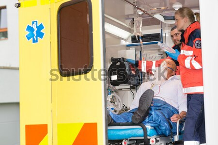 Paramedics help unconscious woman emergency aid Stock photo © CandyboxPhoto