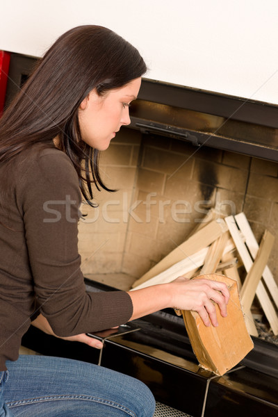 Home fireplace woman put wood logs winter Stock photo © CandyboxPhoto