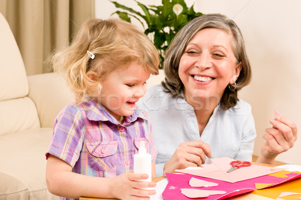 Little girl with grandmother play glue paper Stock photo © CandyboxPhoto