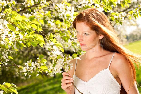 Fiatal nő élvezi tavasz virág fa hosszú Stock fotó © CandyboxPhoto