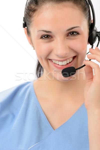 улыбаясь женщины телефон оператор глядя Сток-фото © CandyboxPhoto