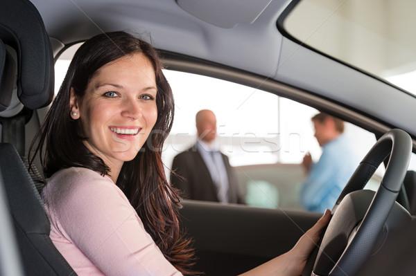 улыбающаяся женщина сидят автомобилей выставочный зал портрет женщину Сток-фото © CandyboxPhoto