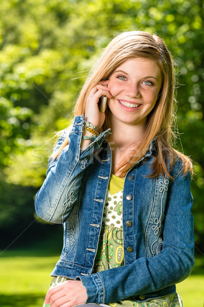 Lively young girl talking on her phone Stock photo © CandyboxPhoto