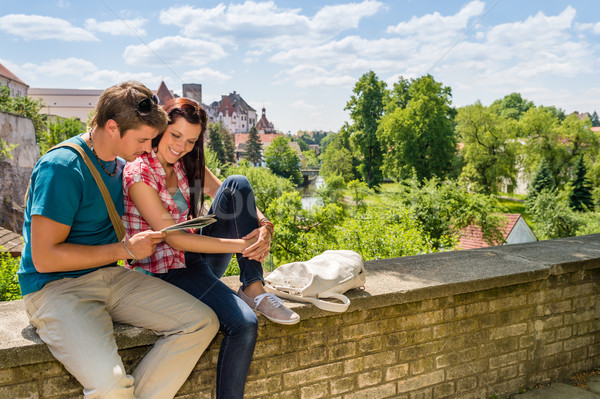 Young couple on vacation looking at map Stock photo © CandyboxPhoto