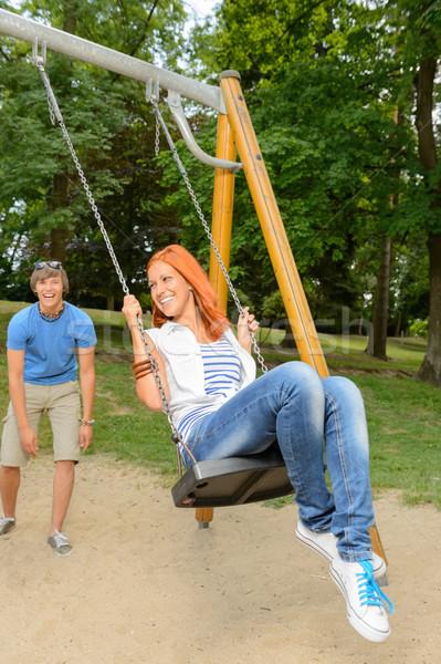 Adolescent couple fille Swing séance Photo stock © CandyboxPhoto