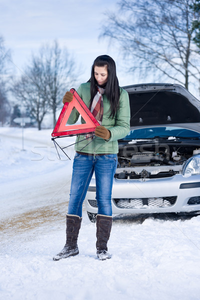 Winter car breakdown - woman warning triangle Stock photo © CandyboxPhoto