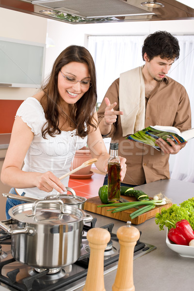 Happy couple cook in kitchen with cookbook Stock photo © CandyboxPhoto