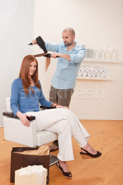 Professional hairdresser with hair dryer at salon  Stock photo © CandyboxPhoto