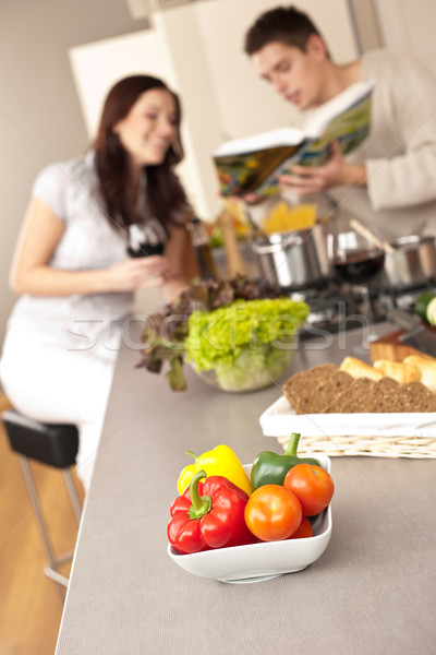Couple in kitchen choosing recipe from cookbook Stock photo © CandyboxPhoto