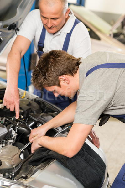 Middle aged car repairman helping colleague Stock photo © CandyboxPhoto