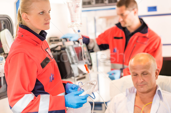 Paramedics in ambulance with patient heart attack Stock photo © CandyboxPhoto