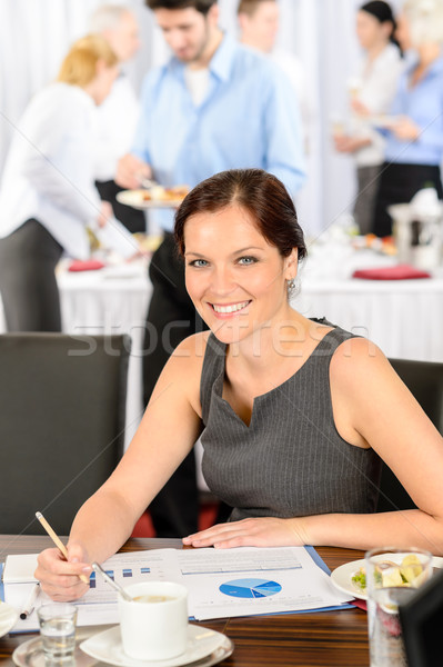 Business woman work during catering buffet Stock photo © CandyboxPhoto