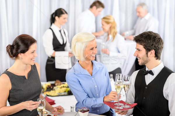 Business woman take aperitif from waiter Stock photo © CandyboxPhoto