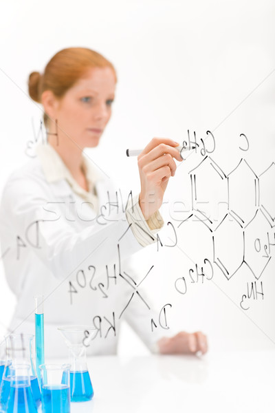 Woman scientist in laboratory write chemical formula Stock photo © CandyboxPhoto