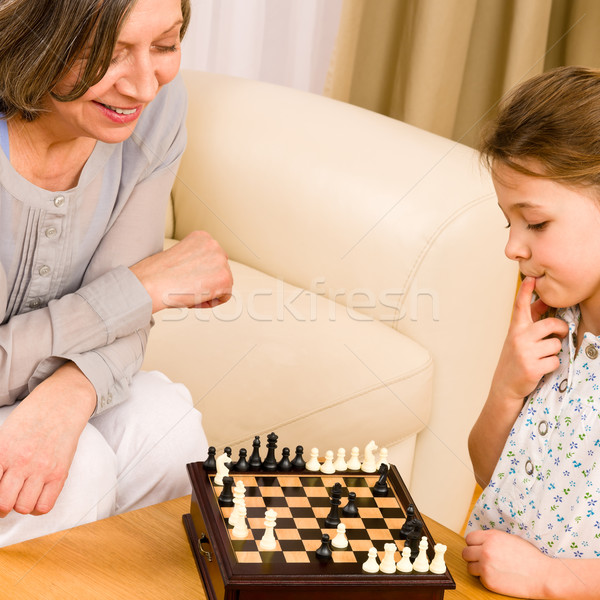 Grandmother and granddaughter play chess together Stock photo © CandyboxPhoto