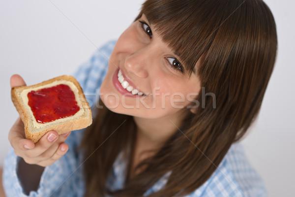 Gelukkig tiener pyjama gezond eten toast ontbijt Stockfoto © CandyboxPhoto