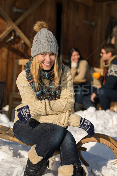 Young woman sitting winter snow sledge cottage Stock photo © CandyboxPhoto