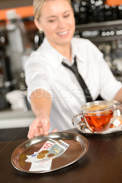 Attractive waitress taking tip in bar EUR Stock photo © CandyboxPhoto