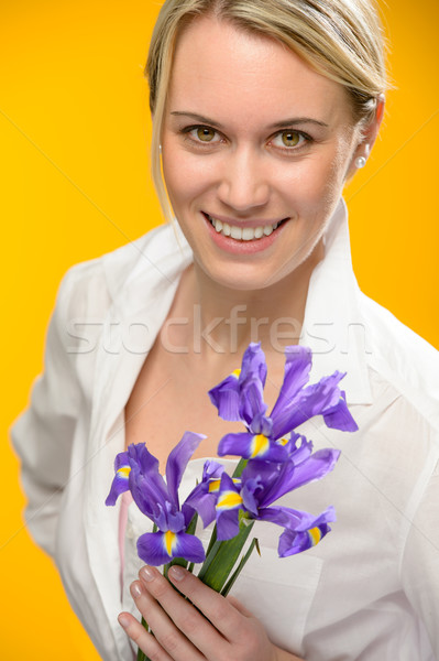 Woman hold one spring iris flower smiling Stock photo © CandyboxPhoto