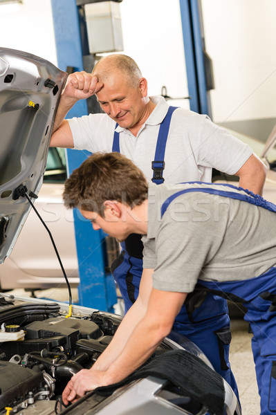 Elderly mechanic supervising  colleague's work Stock photo © CandyboxPhoto