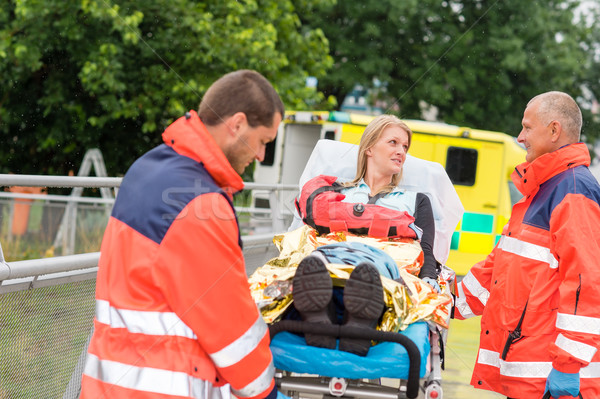 Injured woman talking with paramedics emergency Stock photo © CandyboxPhoto