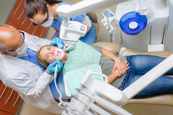 Dentista paciente dental cadeira mulher jovem homem Foto stock © CandyboxPhoto
