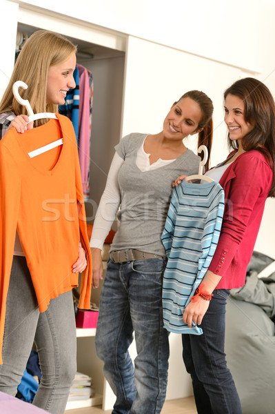 Three teenager girl choosing clothes from closet Stock photo © CandyboxPhoto