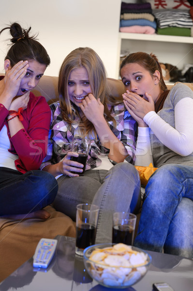 Scared girls watching horror movie on television Stock photo © CandyboxPhoto