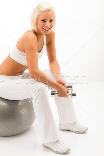 Donna seduta fitness palla tenere manubri Foto d'archivio © CandyboxPhoto