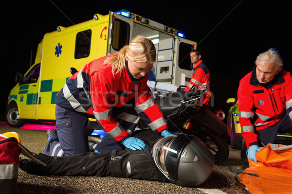 Paramedical team assisting injured motorbike driver Stock photo © CandyboxPhoto