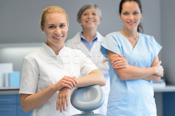 Three professional dentist woman at dental surgery Stock photo © CandyboxPhoto