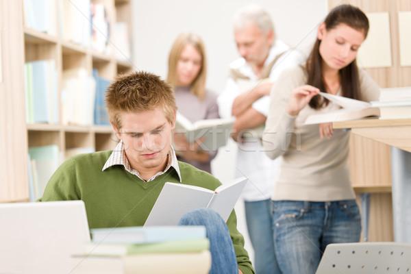 Középiskola könyvtár diák könyv laptop ül Stock fotó © CandyboxPhoto