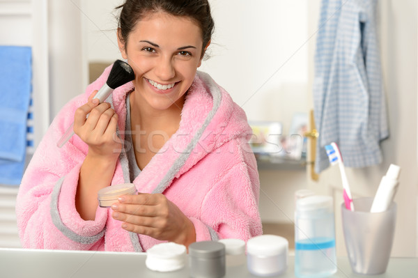 Young woman applying face powder with brush Stock photo © CandyboxPhoto