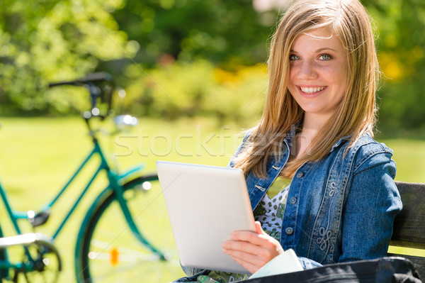 Adolescent girl using tablet computer in park Stock photo © CandyboxPhoto
